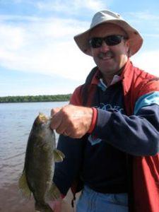 Dennis holding Gary's fish.